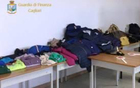 DOMUS DE MARIA, Sequestrati 113 accessori e capi di abbigliamento contraffatti: i due venditori riescono a fuggire